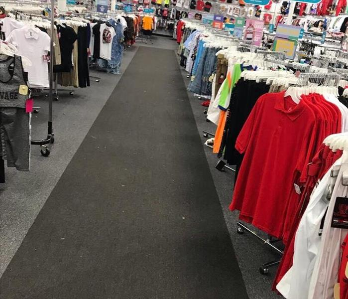 Restored carpet in retail store after flood