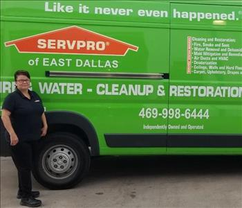 Female employee, Veronica Office Manager next to SERVPRO green truck
